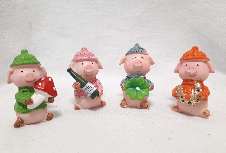 260404 Glücksbringer Schweinchen in Tasche, sortiert